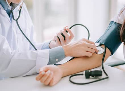 Doctor taking blood pressure in detox drug and alcohol treatment near Seattle, WA